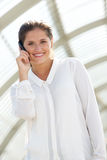 Happy young business woman talking on mobile phone Royalty Free Stock Photography