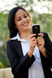 Happy young business woman texting at outdoors Stock Images