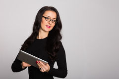 Happy young business woman using a tablet computer Royalty Free Stock Photos
