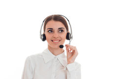 Happy young business woman working in call center with headphones and microphone looking aside and smiling isolated on Royalty Free Stock Photography