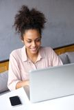 Happy young business woman working on laptop Stock Photo