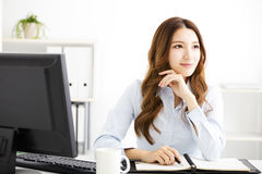 Happy young business woman working in office royalty free stock photography