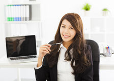 Happy young business woman working in the office Stock Photos