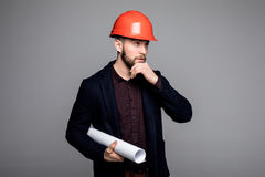 Happy young businessman architect on grey background Royalty Free Stock Photos