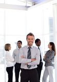 Happy young businessman with arms crossed Stock Photo