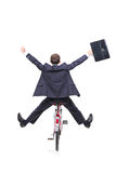 Happy young businessman on a bicycle Stock Images