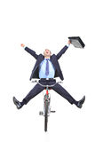 Happy young businessman on a bicycle Royalty Free Stock Photography