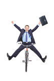 Happy young businessman on a bicycle Royalty Free Stock Photo