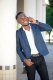 Happy young businessman calling by mobile phone Royalty Free Stock Photography