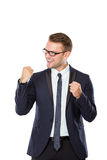 Happy young businessman celebrating victory Royalty Free Stock Images