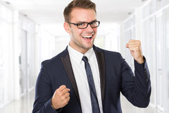Happy young businessman celebrating victory Stock Image