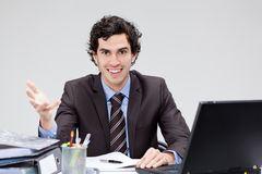 Happy young businessman at desk Stock Photography