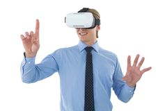 Happy young businessman gesturing while wearing futuristic glasses Royalty Free Stock Images