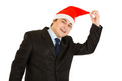 Happy young businessman in hat of Santa Claus Royalty Free Stock Photos