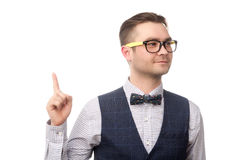 Happy young businessman holding forefinger up isolated on white Royalty Free Stock Photography
