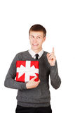 Happy young businessman holding a gift box Stock Photography