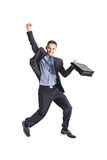 A happy young businessman jumping. In the air isolated on white background stock photography