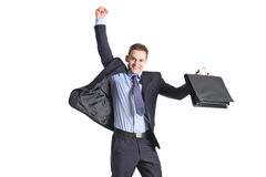 A happy young businessman jumping in the air. Isolated on white background Royalty Free Stock Image