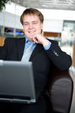 Happy young businessman with laptop Royalty Free Stock Image