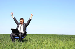 Happy young businessman and laptop Stock Photos