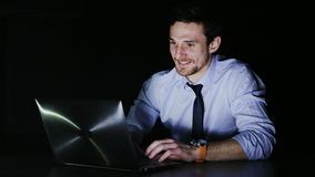 Happy young businessman during overtime stock video