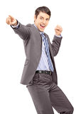 Happy young businessman pointing with his finger and gesturing h Royalty Free Stock Images