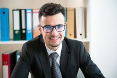 Happy young businessman. Portrait in office Stock Photo