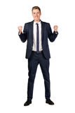 Happy young businessman raised fists. On white Royalty Free Stock Images