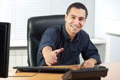 Happy young businessman ready to seal a deal. Happy young businessman in his office ready to seal a deal Royalty Free Stock Photo