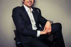 Happy young businessman in relaxed pose Stock Photography