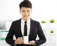 Happy young  businessman relaxing in office Stock Photography