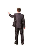 Happy young businessman's back pointing finger Royalty Free Stock Photos