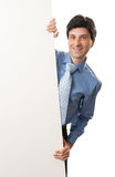 Happy young businessman showing blank signboard Royalty Free Stock Photo