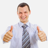 Happy young businessman showing thumb up stock photos