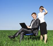 Happy young businessman on spring field Stock Photo
