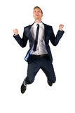 Happy young businessman in suit jumping. On white Royalty Free Stock Image