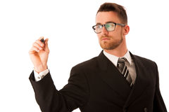 Happy young businessman in suit and tie presenting, promoting, a Royalty Free Stock Photos