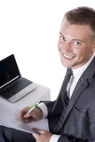 Happy young businessman using laptop in business Royalty Free Stock Image