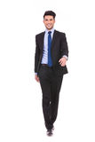 Happy young businessman walking forward Royalty Free Stock Photography