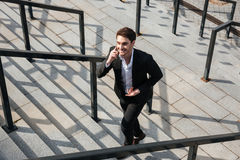 Happy young businessman walking outdoors Royalty Free Stock Images