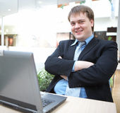 Happy Young Businessman With Laptop Stock Photo