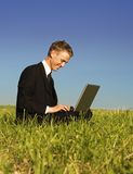 Happy young businessman workin Stock Photography