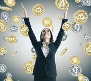 Lottery win and trade concept. Happy young businesswoman with bitcoin rain. Lottery win and trade concept royalty free stock photography