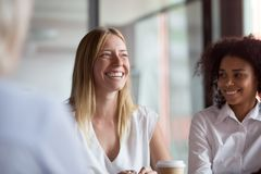 Happy young businesswoman coach mentor leader laughing at group meeting. Happy young businesswoman coach mentor leader laughing at funny joke at group business royalty free stock photos