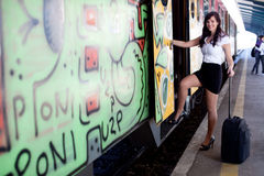 Happy young businesswoman getting on the train Royalty Free Stock Photography