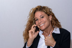 Happy young businesswoman giving a thumbs up Royalty Free Stock Photography