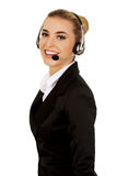 Happy young businesswoman with headset Royalty Free Stock Photography