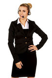 Happy young businesswoman with headset Royalty Free Stock Photo