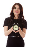 Happy young businesswoman holding alarm clock Royalty Free Stock Image