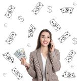 Young businesswoman holding American dollars and talking on phone against white background with drawn money. Happy young businesswoman holding American dollars stock images